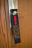 Do not disturb sign on a door