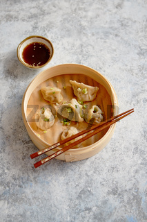 Delicious chinese dumplings served in wooden bamboo steamer