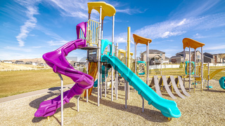 Panorama Colorful blue and purple slides in kids playground