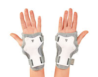 Roller skater wearing wards guards protector pads, wrist protection on hands woman