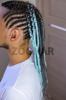 thin braids in African style, French braids on the head of a man