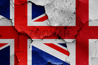 flags of UK and England painted on cracked wall
