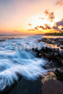 Evening Sunset at a Tropical Rocky Beach