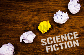 Text sign showing Science Fiction. Conceptual photo Fantasy Entertainment Genre Futuristic Fantastic Adventures Ideas concepts words on wooden background crumpled papers several tries.