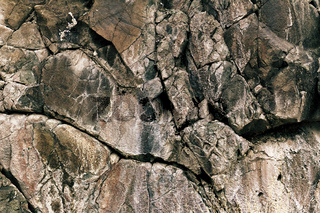 Grungy gray stone background with cracks
