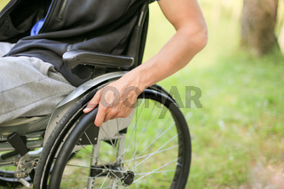 Disabled man on wheelchair in nature