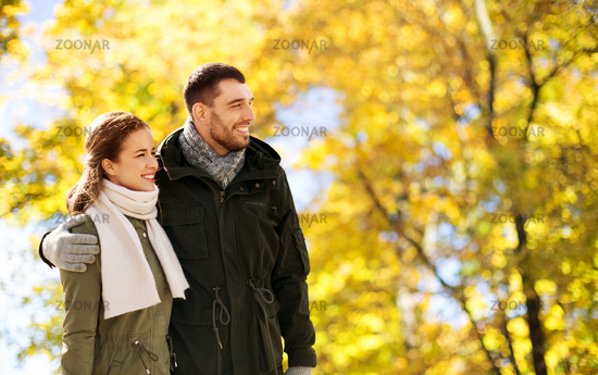 smiling couple hugging in autumn park