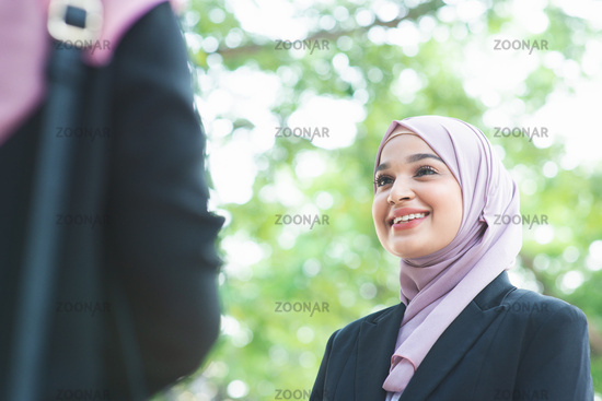 Muslim business woman talking