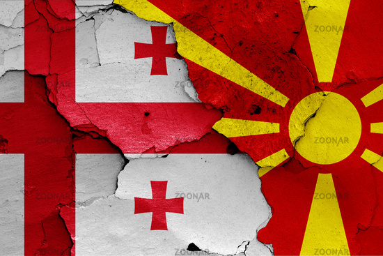 flags of Georgia and North Macedonia painted on cracked wall