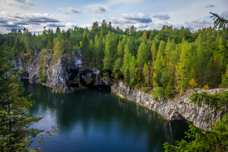 Marble quarry Ruskeala. Invalid marble quarry. Sights of Karelia in Russia. Quarry marble. Pieces of marble.