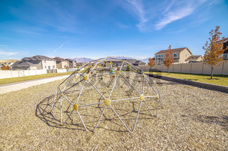 Metal climbing dome with nets in a playground