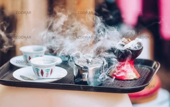 cup of Ethopian coffee with aromatic frankincense