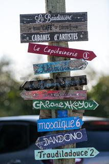 Popular tourist destination, Tourist signs weathered