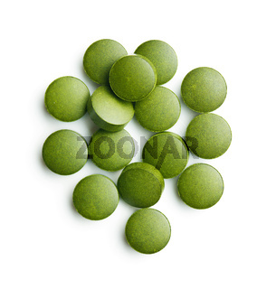 Green chlorella pills or green barley pills.