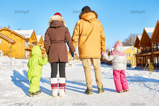 Family enjoying winter holidays