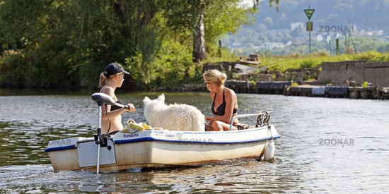 Boat with two women and a dog on the river Ruhr, Witten, North Rhine-Westphalia, Germany, Europe