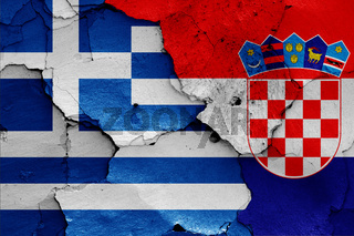 flags of Greece and Croatia painted on cracked wall