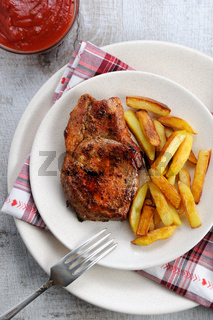 pork steak on dice with potatoes