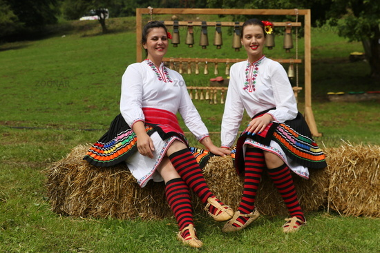 People in traditional authentic folk costumes