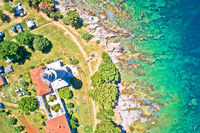 Savudrija lighthouse and turquoise crystal clear rocky beach aerial view