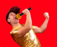 The excited singer with a microphone on red background