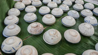 Thai coconut dessert in a cup, Traditional Thai dessert in the ceramic bowl made with coconut milk, sugar, salt, flour and then steamed.