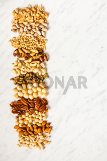 Vegetarian food with place for text, various nuts