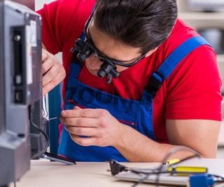 Professional repair engineer repairing broken tv