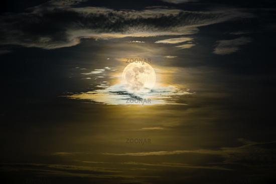 Full moon on the golden sky at night