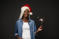 African Girl in Christmas Hat Holds Bengal Fire