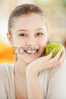 young beautiful woman close up with a big green apple
