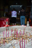 Incense sticks burning inside the pot in Buddhist temple