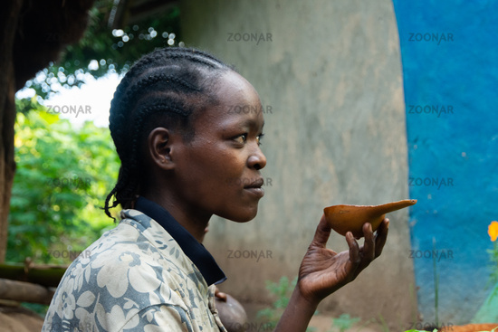 Ethiopian woman drinking coffee