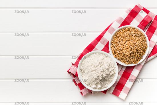 Whole grain wheat flour and wheat grains.