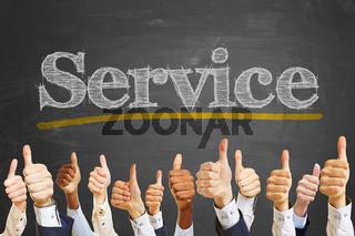 Business Daumen hoch vor Spruch 'Service'