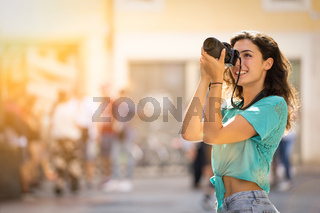 Girl tourist or professional photographer who shoots in a typical Italian city.