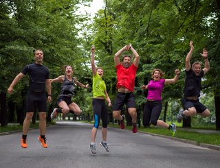 runners team jumping in the air during  morning training
