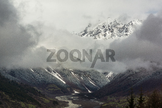clouds in front of mountain in caucasus