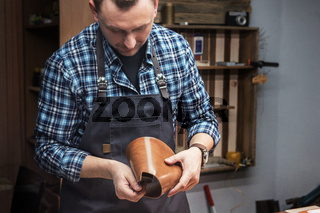 Concept of handmade craft production of leather goods.
