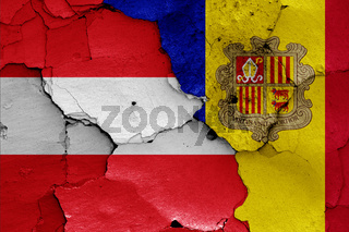 flags of Austria and Andorra painted on cracked wall