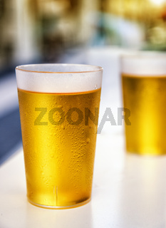 Two misted plastic beer cups