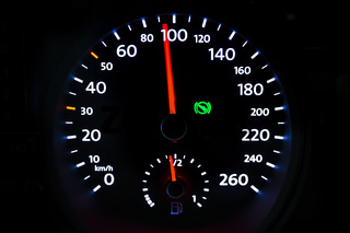 Modern light car mileage on black background
