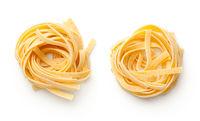 Raw Tagliatelle Pasta Nests Isolated On White Background