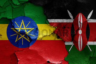 flags of Ethiopia and Kenya painted on cracked wall