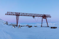 Crane in winter landscape at Pyramiden, Svalbard.
