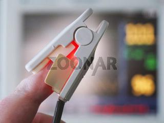 pulse oximeter on hospital patient finger