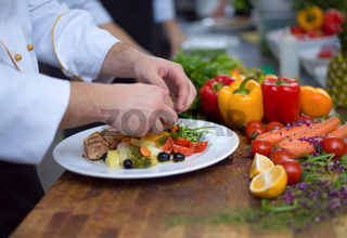cook chef decorating garnishing prepared meal