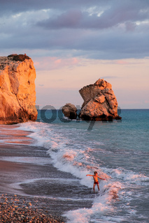 A boy plays at the beach at the Petra tou Romiou rocks, in Paphos, Cyprus.