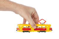 Hand with toy tram