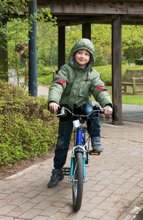 Blond boy enjoying bicycle ride